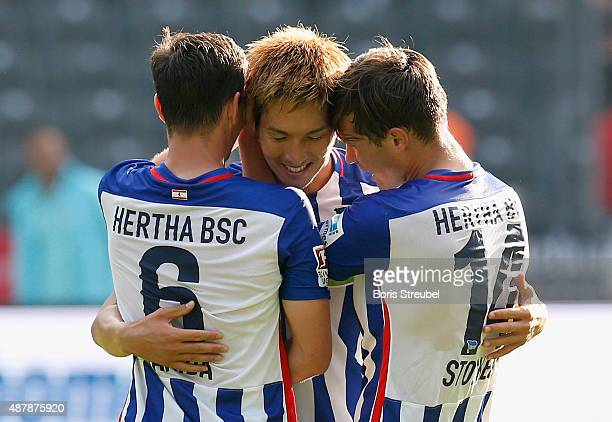 Genki Haraguchi celebrates with team mates after winning the Bundesliga match between Hertha BSC and Vfb Stuttgart at Olympiastadion on September 12...