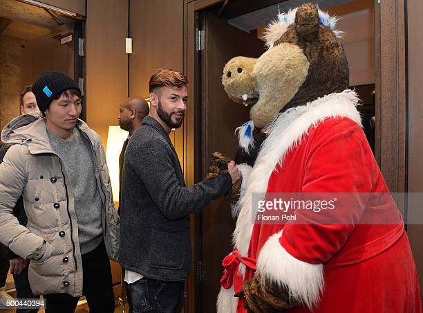 Genki Haraguchi Marvin Plattenhardt and mascot Herthinho of Hertha BSC during the Christmas party of Hertha BSC on December 8 2015 in Berlin Germany