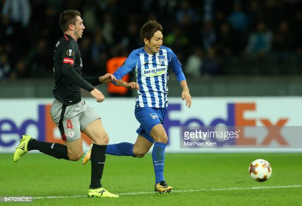 Genki Haraguchi of Berlin battles for the ball with Aymeric Laporte of Bilbao during the UEFA Europa League group J match between Hertha BSC and...