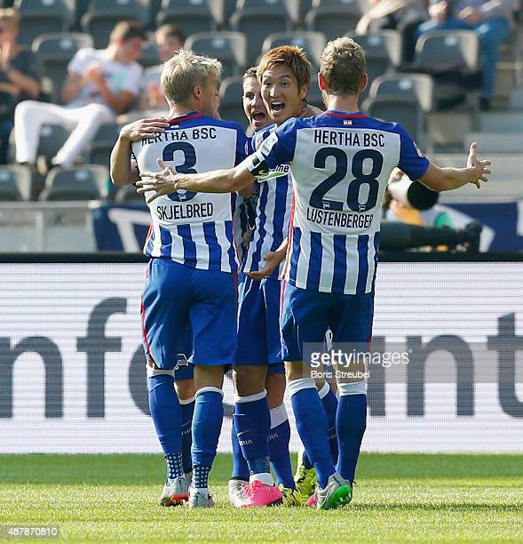 Genki Haraguchi of Berlin celebrates his team's first goal with team mates during the Bundesliga match between Hertha BSC and Vfb Stuttgart at...