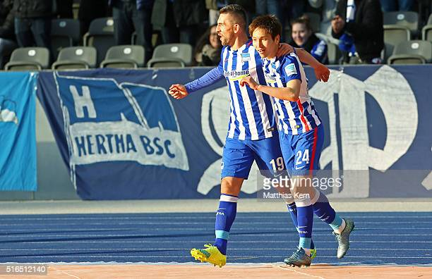 Genki Haraguchi of Berlin jubilates with team mate Vedad Ibisevic after scoring the first goal during the Bundesliga match between Hertha BSC and FC...