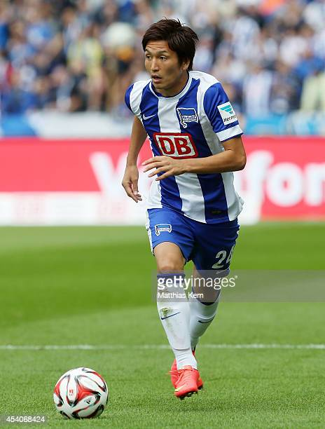 Genki Haraguchi of Berlin runs with the ball during the Bundesliga match between Hertha BSC and SV Werder Bremen at Olympiastadion on August 23 2014...