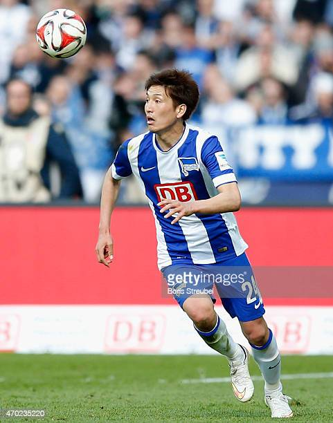Genki Haraguchi of Berlin runs with the ball during the Bundesliga match between Hertha BSC and 1 FC Koeln at Olympiastadion on April 18 2015 in...