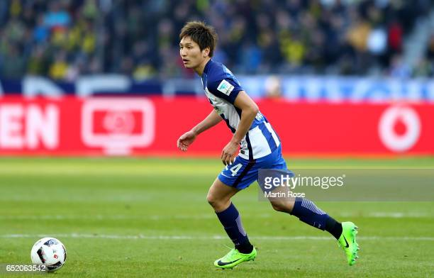 Genki Haraguchi of Berlin runs with the ball during the Bundesliga match between Hertha BSC and Borussia Dortmund at Olympiastadion on March 11 2017...