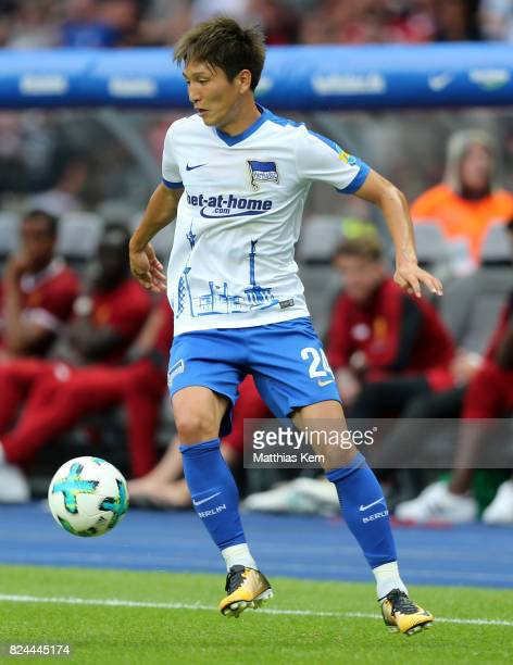 Genki Haraguchi of Berlin runs with the ball during the pre season friendly match between Hertha BSC and FC Liverpool at Olympiastadion on July 29...