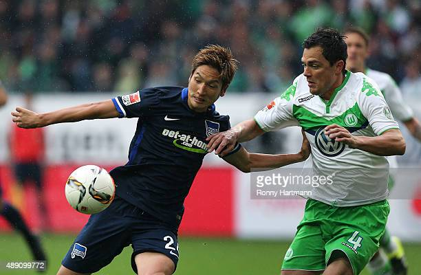 Genki Haraguchi of Berlin vies with Marcel Schaefer of Wolfsburg during the Bundesliga match between VfL Wolfsburg and Hertha BSC at Volkswagen Arena...