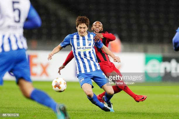 Genki Haraguchi of Hertha Berlin SC and Fouad Bachirou of Ostersunds FK competes for the ball during the UEFA Europa League group J match between...