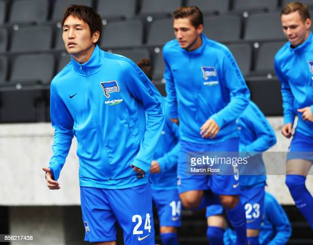 Genki Haraguchi of Hertha Berlin warms up before the Bundesliga match between Hertha BSC and FC Bayern Muenchen at Olympiastadion on October 1 2017...