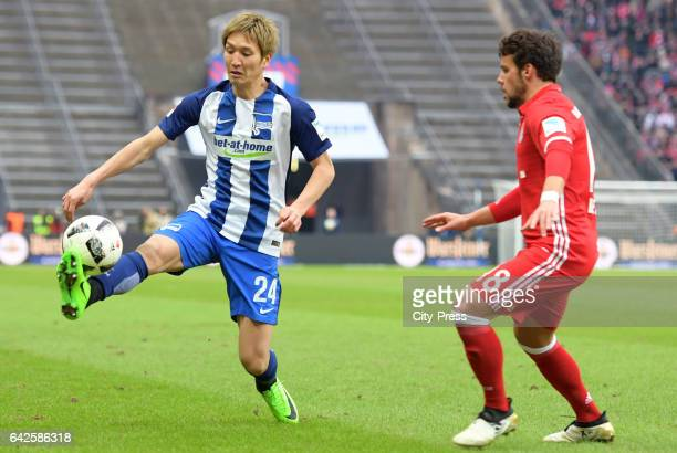 Genki Haraguchi of Hertha BSC and Juan Bernat of FC Bayern Muenchen during the game between Hertha BSC and FC Bayern Muenchen on February 18 2017 in...