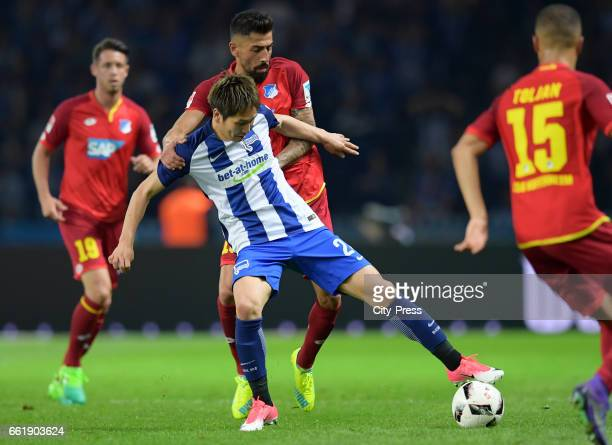 Genki Haraguchi of Hertha BSC and Kerem Demirbay of the TSG 1899 Hoffenheim during the game between Hertha BSC and TSG Hoffenheim on march 31 2017 in...