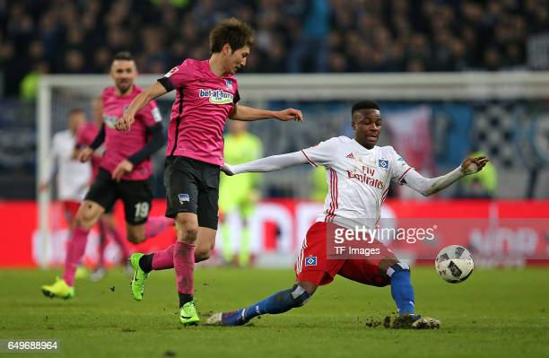 Genki Haraguchi of Hertha BSC Berlin and Gideon Jung of Hamburg battle for the ball during the Bundesliga match between Hamburger SV and Hertha BSC...