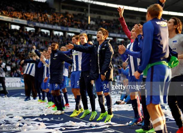 Genki Haraguchi of Hertha BSC celebrates the 21 win teammates and fans after the Bundesliga match between Hertha BSC and Borussia Dortmund at the...