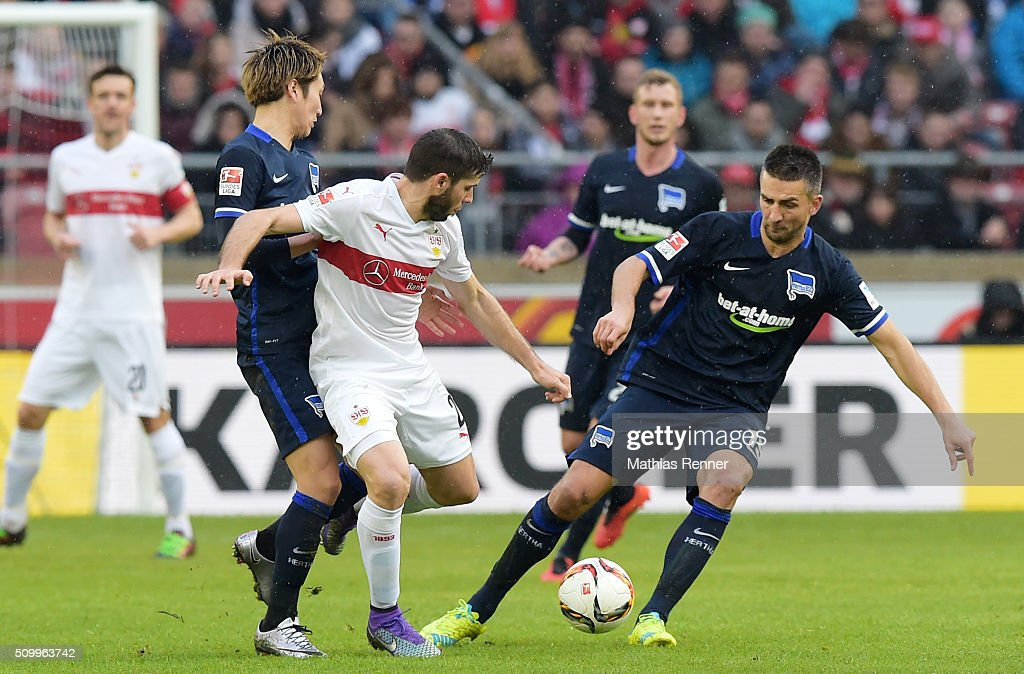 <a gi-track='captionPersonalityLinkClicked' href=/galleries/search?phrase=Genki+Haraguchi&family=editorial&specificpeople=5473188 ng-click='$event.stopPropagation()'>Genki Haraguchi</a> of Hertha BSC, <a gi-track='captionPersonalityLinkClicked' href=/galleries/search?phrase=Emiliano+Insua&family=editorial&specificpeople=4125596 ng-click='$event.stopPropagation()'>Emiliano Insua</a> of VfB Stuttgart and <a gi-track='captionPersonalityLinkClicked' href=/galleries/search?phrase=Vedad+Ibisevic&family=editorial&specificpeople=535857 ng-click='$event.stopPropagation()'>Vedad Ibisevic</a> of Hertha BSC during the game between dem VfB Stuttgart and Hertha BSC on February 13, 2016 in Stuttgart, Germany.
