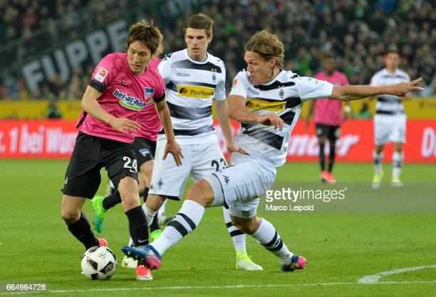 Genki Haraguchi of Hertha BSC Jonas Hofmann and Jannik Vestergaard of Borussia Moenchengladbach during the Bundesliga match between Borussia...