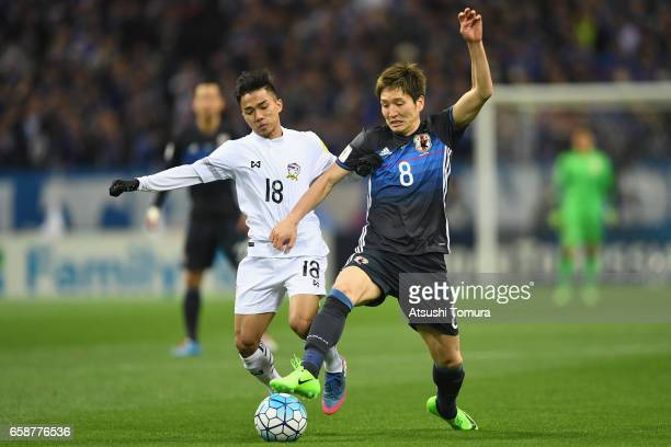 Genki Haraguchi of Japan and Chanathip Songkrasin of Thailand compete for the ball during the 2018 FIFA World Cup Qualifier match between Japan and...