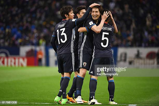 Genki Haraguchi of Japan celebrates scoring his team's fifth goal with his team mates during the FIFA World Cup Russia Asian Qualifier second round...