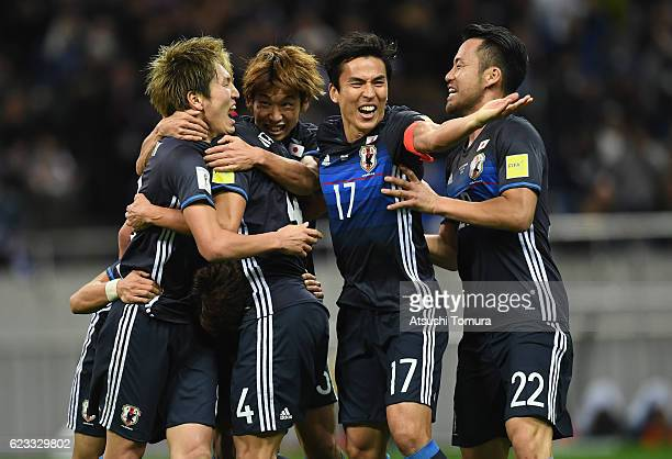 Genki Haraguchi of Japan celebrates scoring his team's second goal with his team mates during the 2018 FIFA World Cup Qualifier match between Japan...