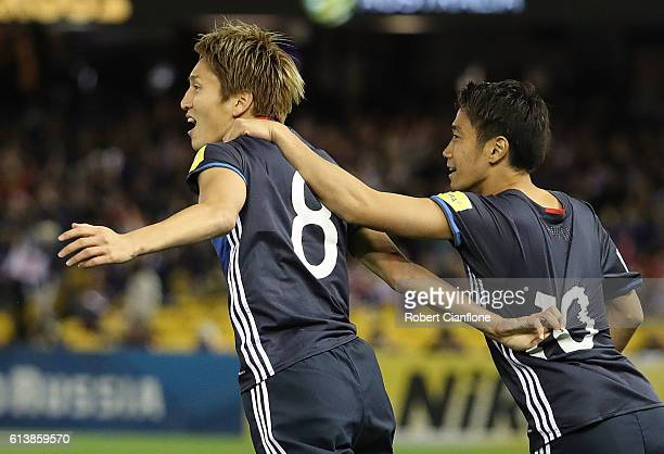 Genki Haraguchi of Japan celebrates with Shinji Kagawa after scoring a goal during the 2018 FIFA World Cup Qualifier match between the Australian...
