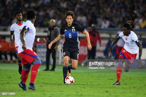 Genki Haraguchi of Japan controls the ball under pressure of Haiti defense during the international friendly match between Japan and Haiti at Nissan...