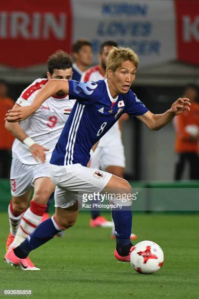Genki Haraguchi of Japan dribbles the ball during the international friendly match between Japan and Syria at Tokyo Stadium on June 7 2017 in Chofu...