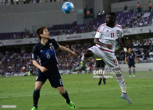 Genki Haraguchi of Japan in action against Ahmed Barman of United Arab Emirates during the 2018 FIFA World Cup Asian Qualifying group B football...