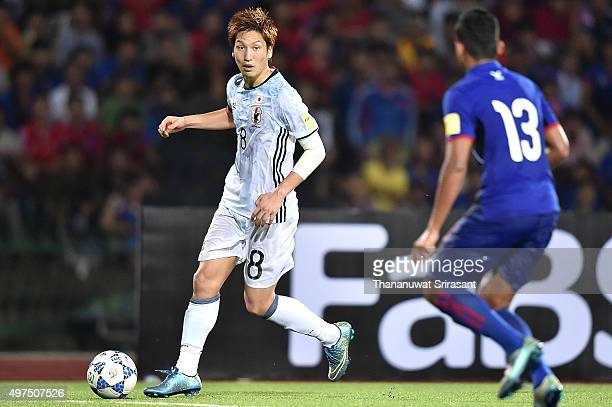 Genki Haraguchi of Japan runs with the ball during the 2018 FIFA World Cup Qualifier match between Cambodia and Japan on November 17 2015 in Phnom...