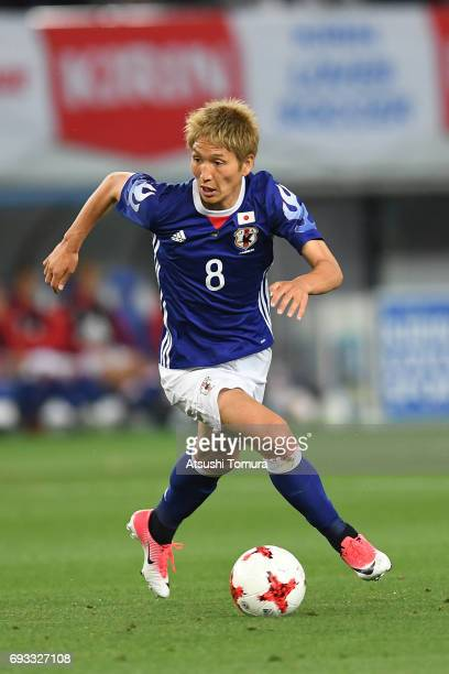 Genki Haraguchi of Japan runs with the ball during the international friendly match between Japan and Syria at Tokyo Stadium on June 7 2017 in Chofu...
