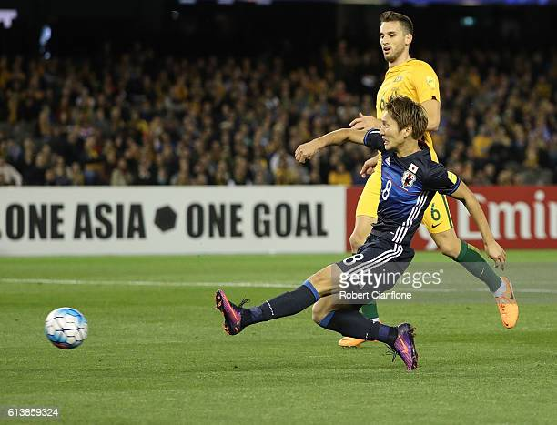 Genki Haraguchi of Japan shoots on goal to score during the 2018 FIFA World Cup Qualifier match between the Australian Socceroos and Japan at Etihad...