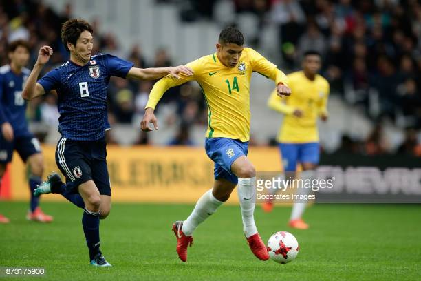 Genki Haraguchi of Japan Thiago Silva of Brazil during the International Friendly match between Japan v Brazil at the Stade Pierre Mauroy on November...