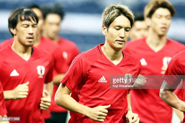 Genki Haraguchi of Japan with teammate in action during a Japan training session/press conference ahead of the FIFA World Cup qualifier against...