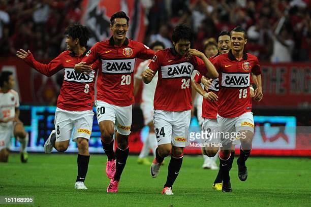 Genki Haraguchi of Urawa Red Diamonds celebrates scoring their first goal withi his team mates Yosuke Kashiwagi Tomoaki Makino and Marcio Richardes...