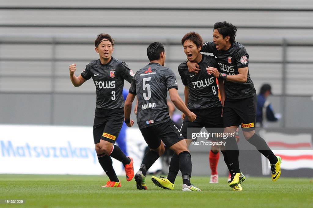 <a gi-track='captionPersonalityLinkClicked' href=/galleries/search?phrase=Genki+Haraguchi&family=editorial&specificpeople=5473188 ng-click='$event.stopPropagation()'>Genki Haraguchi</a> of Urawa Red Diamonds celebrates the equaliser with his team mates during the J. League match between Nagoya Grampus and Urawa Red Diamonds at the Toyota Stadium on April 12, 2014 in Toyota, Japan.
