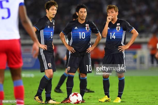 Genki Haraguchi Shinji Kagawa and Takahi Inui of Japan look on during the international friendly match between Japan and Haiti at Nissan Stadium on...
