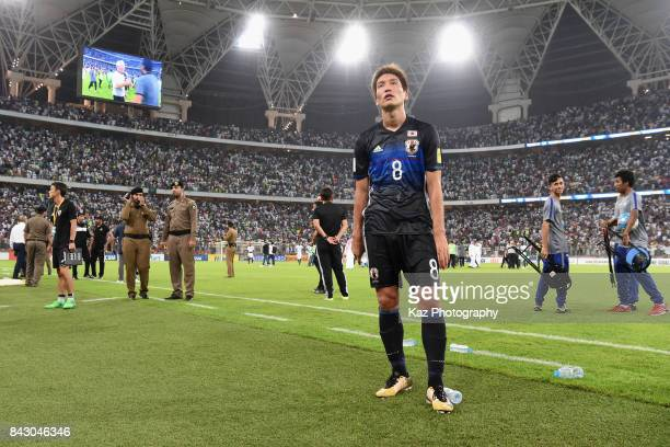 Genki Haraguchi shows dejection after his side's 01 defeat in the FIFA World Cup qualifier match between Saudi Arabia and Japan at the King Abdullah...