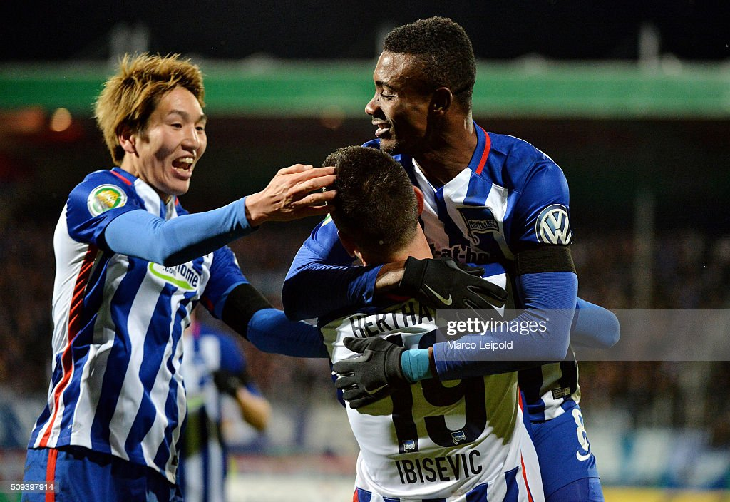 <a gi-track='captionPersonalityLinkClicked' href=/galleries/search?phrase=Genki+Haraguchi&family=editorial&specificpeople=5473188 ng-click='$event.stopPropagation()'>Genki Haraguchi</a>, <a gi-track='captionPersonalityLinkClicked' href=/galleries/search?phrase=Vedad+Ibisevic&family=editorial&specificpeople=535857 ng-click='$event.stopPropagation()'>Vedad Ibisevic</a> and <a gi-track='captionPersonalityLinkClicked' href=/galleries/search?phrase=Salomon+Kalou&family=editorial&specificpeople=453312 ng-click='$event.stopPropagation()'>Salomon Kalou</a> of Hertha BSC celebrate after scoring the 1:1 during the cup match between 1. FC Heidenheim and Hertha BSC on february 10, 2016 in Heidenheim, Germany.