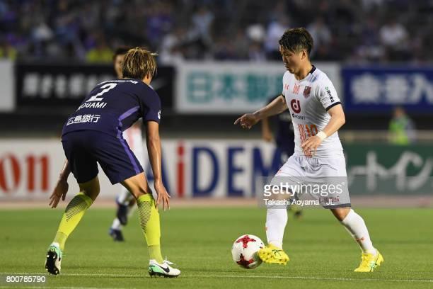 Genki Omae of Omiya Ardija takes on Yuki Nogami of Sanfrecce Hiroshima during the JLeague J1 match between Sanfrecce Hiroshima and Omiya Ardija at...