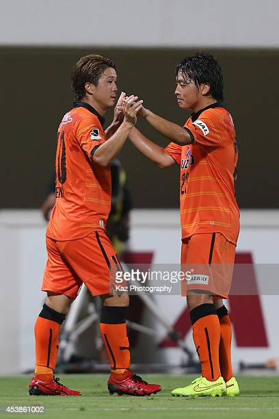 Genki Omae of Shimizu SPulse celebrates scoring his team's first goal with his teammate Yoshiaki Takagi during the Emperor's Cup third round match...