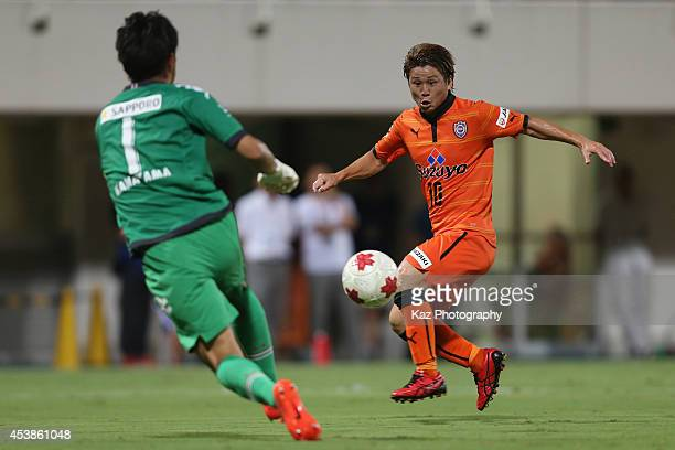 Genki Omae of Shimizu SPulse scores his team's first goal past Junki Kanayama of Consadole Sapporo during the Emperor's Cup third round match between...