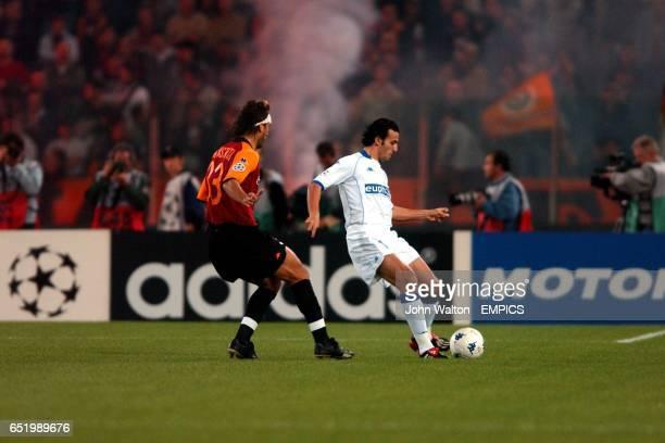 RC Genk's Akran Roumani is shadowed by Roma's Gabriel Omar Batistuta