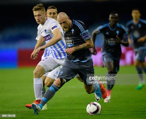 Genk's Czech defender Jakub Brabec vies with Celta Vigo's Swedish forward John Guidetti during the UEFA Europa League quarter final 1st leg football...