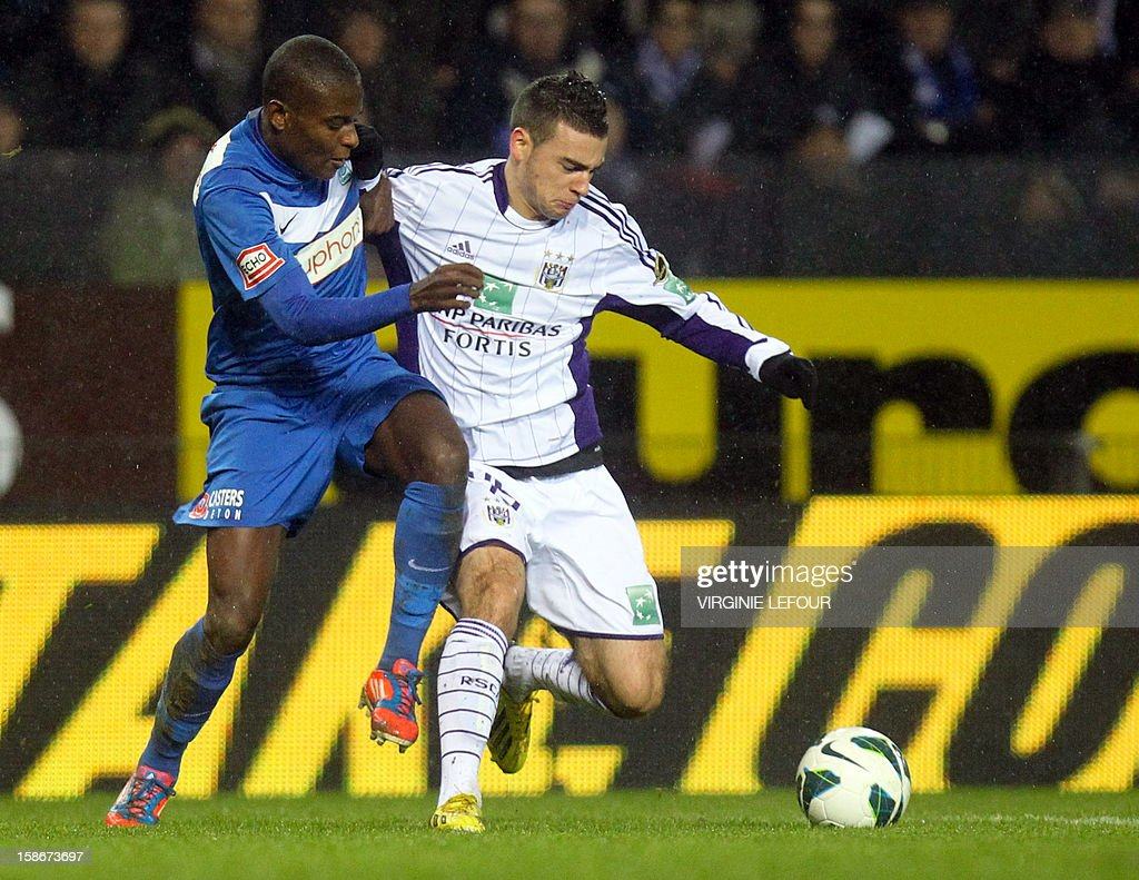 Genk's Derrick Tshimanga (L) and Anderlecht's Massimo Bruno fight for the ball during the Jupiler Pro League match between KRC Genk and RSCA Anderlecht, in Genk, on December 23, 2012.