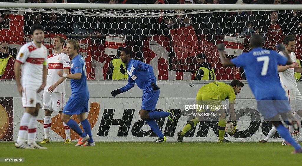 Genk's Dutch forward Glynor Plet (C) celebrates after he scored past Stuttgart's goalkeeper Sven Ulreich during the UEFA Europa League football match Stuttgart - KRC Genk on February 14, 2013 in Stuttgart, southern Germany. The match ended in a 1-1 draw.