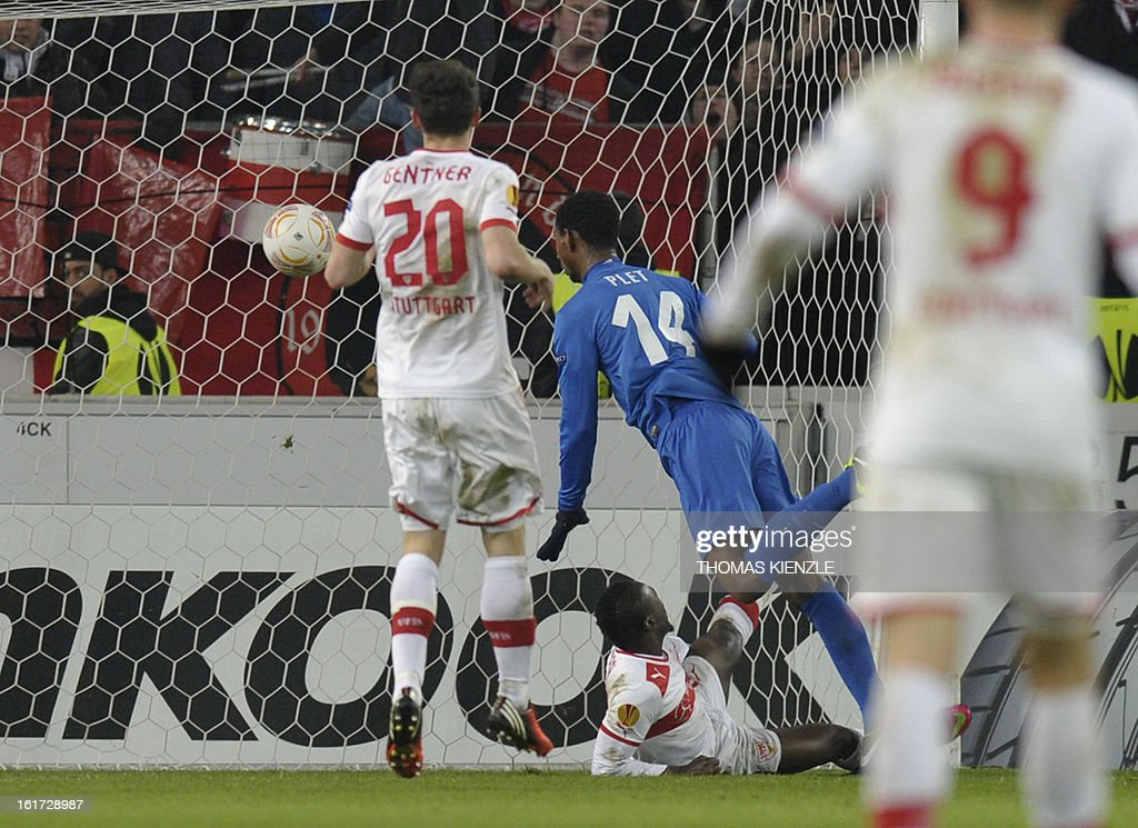 Genk's Dutch forward Glynor Plet (C) scores past Stuttgart's Ivorian defender Arthur Boka (on ground) during the UEFA Europa League football match Stuttgart - KRC Genk on February 14, 2013 in Stuttgart, southern Germany. The match ended in a 1-1 draw.