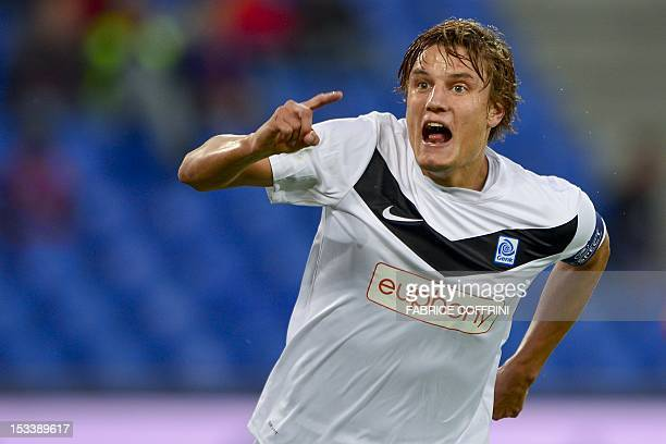 Genk's forward Jelle Vossen reacts after he scored his team's first goal during an UEFA Europa League group G football match between FC Basel against...