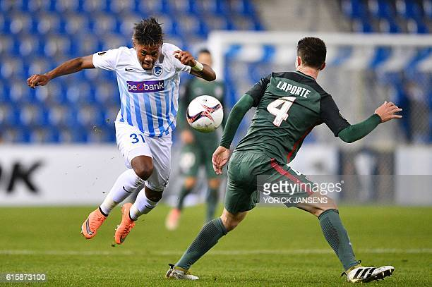 Genk's forward Leon Bailey vies with Athletic's defender Aymeric Laporte during the Europa league group football match between RC Genk and Athletic...