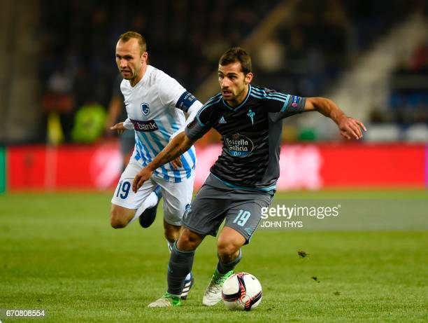 Genk's forward Thomas Buffel and Celta's defender Jonny fight for the ball during the UEFA Europa League quarter final match between KRC Genk and...