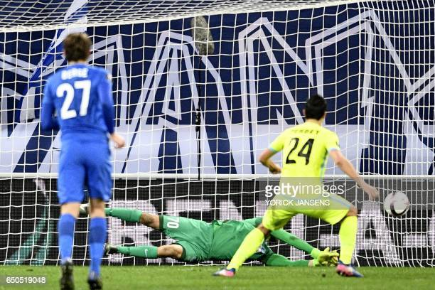 Genk's goalkeeper Mathew Ryan blocks a penalty shot during the UEFA Europa League round of 16 football match between KAA Gent and KRC Genk in Gent on...