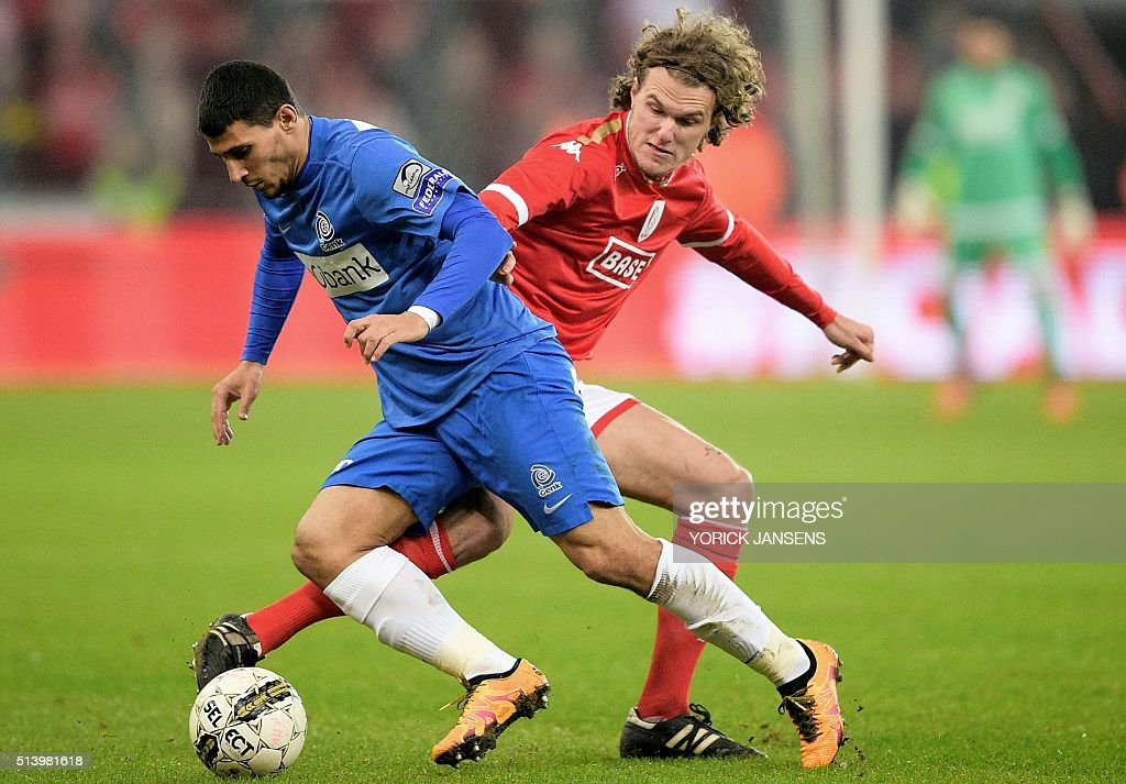 Genk's Greek forward Nikolaos Karelis and Standard's Danish defender Alexander Scholz vie for the ball during the Jupiler Pro League football match...
