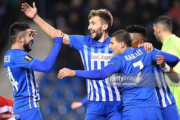 Genk's Greek forward Nikolaos Karelis celebrates with teammates after scoring a goal during the UEFA Europa League football match between RC Genk and...