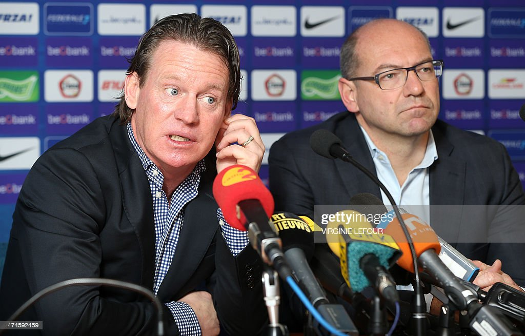 Genk's head coach Mario Been (l) and Genk's general director Dirk Degraen give a press conference on February 24, 2014 of Genk first division soccer club, after they announced the end of the contract with their head coach after the fifth game lost in their stadium, in Genk. AFP PHOTO /VIRGINIE LEFOUR